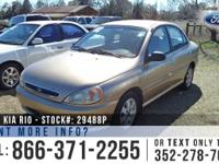 2002 Kia Rio Features: Alloy Wheels - Tinted Windows -