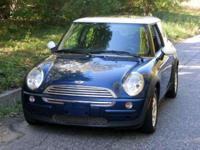 The Vehicle ... ... 2002 Mini Cooper in blue with a