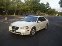 pearl white 2002 Nissan Maxima GLE with 144k miles