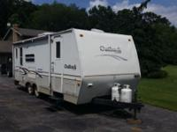 Outback. 2005. 25 foot while towing. 30 foot while