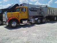 This is a 2002 Peterbilt 379 daycab semi with one