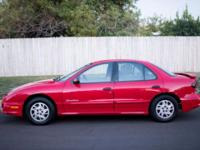 Offering my red 2002 Pontiac Sunfire SE. Automobile has