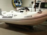 Seadoo Explorer stiff inflatable hard bottom jet boat.