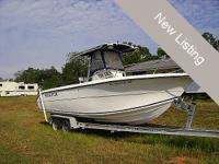 This 2002 26 Sea Fox Center Console has a T-Top and a