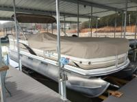 I'm selling a 22 foot pontoon that's located on Table
