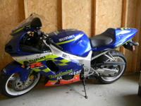 This is a 2002 Suzuki GSXR 600 Teleifonica sport bike.