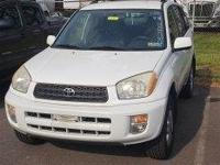 Clean CARFAX. White 2002 Toyota RAV4 AWD 4-Speed