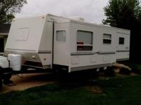 31Foot super slide well maintained travel trailer.