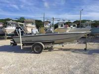 This 2003 17' Release Flats Boat is powered by a 125hp