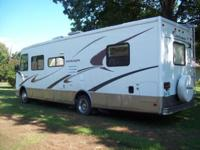 That's right just 7500 miles 2003 Coachman Mirada. VIN