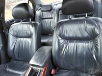 Silver with black leather interior. Mileage is approx.