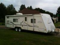We are selling our camper to upgrade.  Queen bed up