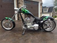2003 Big Dog, lots of chrome, very loud pipes, green