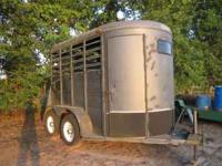 2003 Big Horn 2 horse straight load/stock trailer.