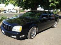 2003 Cadillac DTS. Black on Black. Vogue wheels with