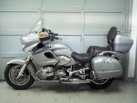 2003 BMW R1200CL, metallic silver with 46k miles. This