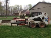 2003 Bobcat 773 Turbo plus trailer and accessories.