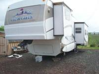 2003 Cedar Creek 5th Wheel Camper by Forest River.