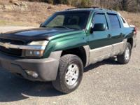 2003 Chevy Avalanche. This truck has push button 4x4,