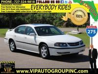 Take a look at this terrific family sedan! 2003 white