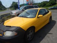 2003 Chevy Cavalier Color is yellow Black Cloth