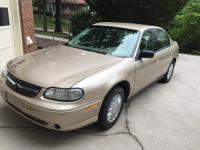 2003 Chevy Malibu. Low miles, gold in color, good