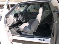 2003 Chevy S-10 White with white fiberglass bed cap low