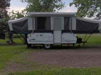 2003 Coleman Folding Camper, has a stove, refrigerator,