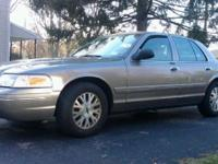 2003 Crown Vic, the high end model, with dual exhaust,
