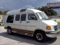 This is a 2003 Dodge Ram 1500 conversion van. It has
