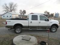 2003 f250 4x4 6.0 diesel lariat. you wont find a nicer