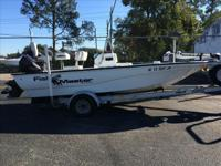 THIS IS A FISHMASTER 18 FT CENTER CONSOLE POWER BY A