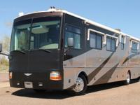 THIS 39ft, FOUR SLIDE CLASS A BUS IS LOADED W/ OPTIONS