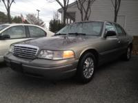 2003 Ford Crown Victoria LX with 144K initial miles. It