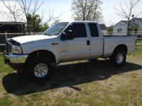 This is an adult owned, 2003 Ford F-250 XLT Super Cab,