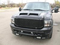 This 2003 Ford Excursion 4dr Limited SUV features a