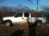 Ford F-250 4x4 crew cab truck, 73,500 miles. Gray cloth