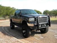 2003 Ford Super Duty Lariat. This truck has the AWSOME