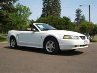You will love this White 2003 Ford Mustang! This