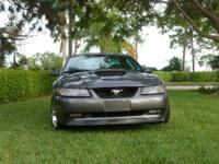 This is a 2003 Ford Mustang GT Premium 4.6L V8. It has