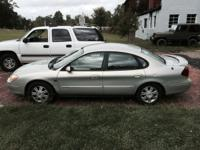2003 Ford Taurus. 132,900 miles. Leather in great
