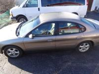 2003 Ford Taurus with 102,000 miles requires a