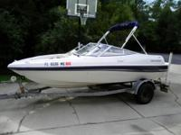 "This is a 16'6"" Four Winns bowrider with a 135 hp"