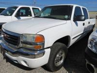 White exterior - tan interior - 2 wheel drive - 4 door