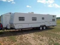 Professionally manufactured Shamrock Dog Trailer. Six