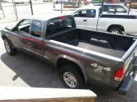 2003 GREY DODGE DAKOTA 4X4, V6, 5 SPEED, 2 DOOR, SITS