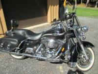 his Road King Classic is in mint condition with 9720
