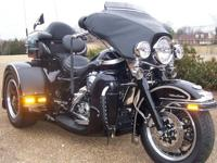 This is a 2003 100th Anniversary Trike. It has a new