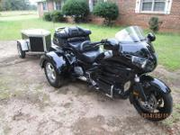 THIS TRIKE LOOKS ,RUNS AND DRIVES LIKE NEW .IT IS
