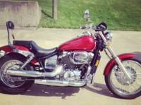 2003 Honda Shadow 750cc, red with ghost flames on tank.